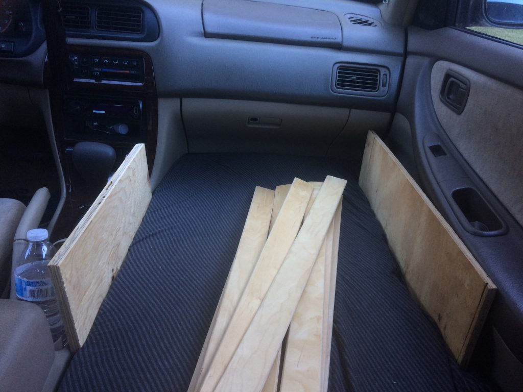 pile of planks in car